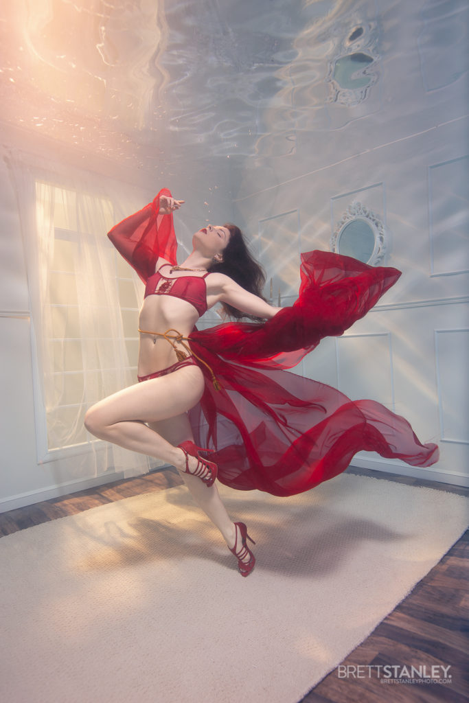 Underwater room or set showing a model posing for underwater photography